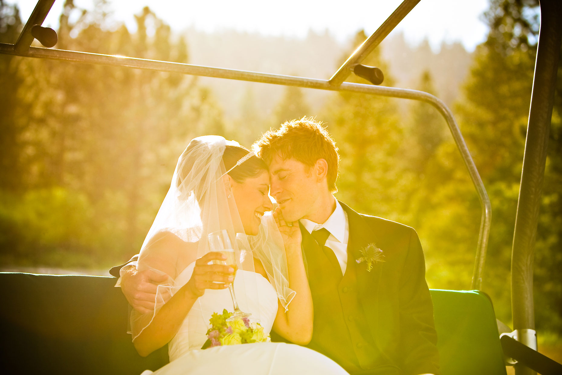 Mammoth mountain wedding photographer on ski lift.