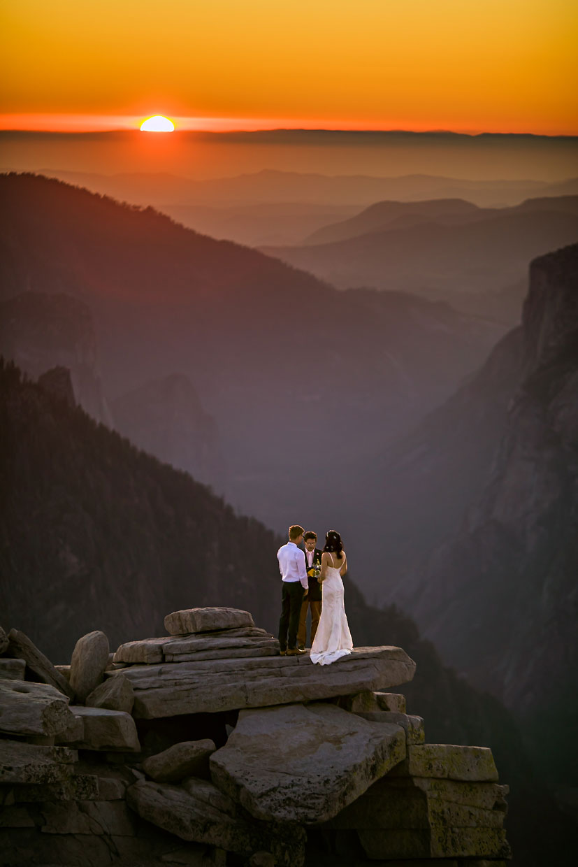Yosemite adventure elopement photographer on Half Dome at sunset.