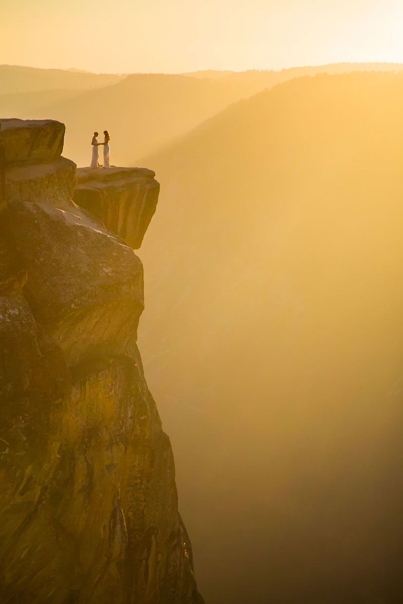 Lesbian wedding photographer at Taft Point in Yosemite.