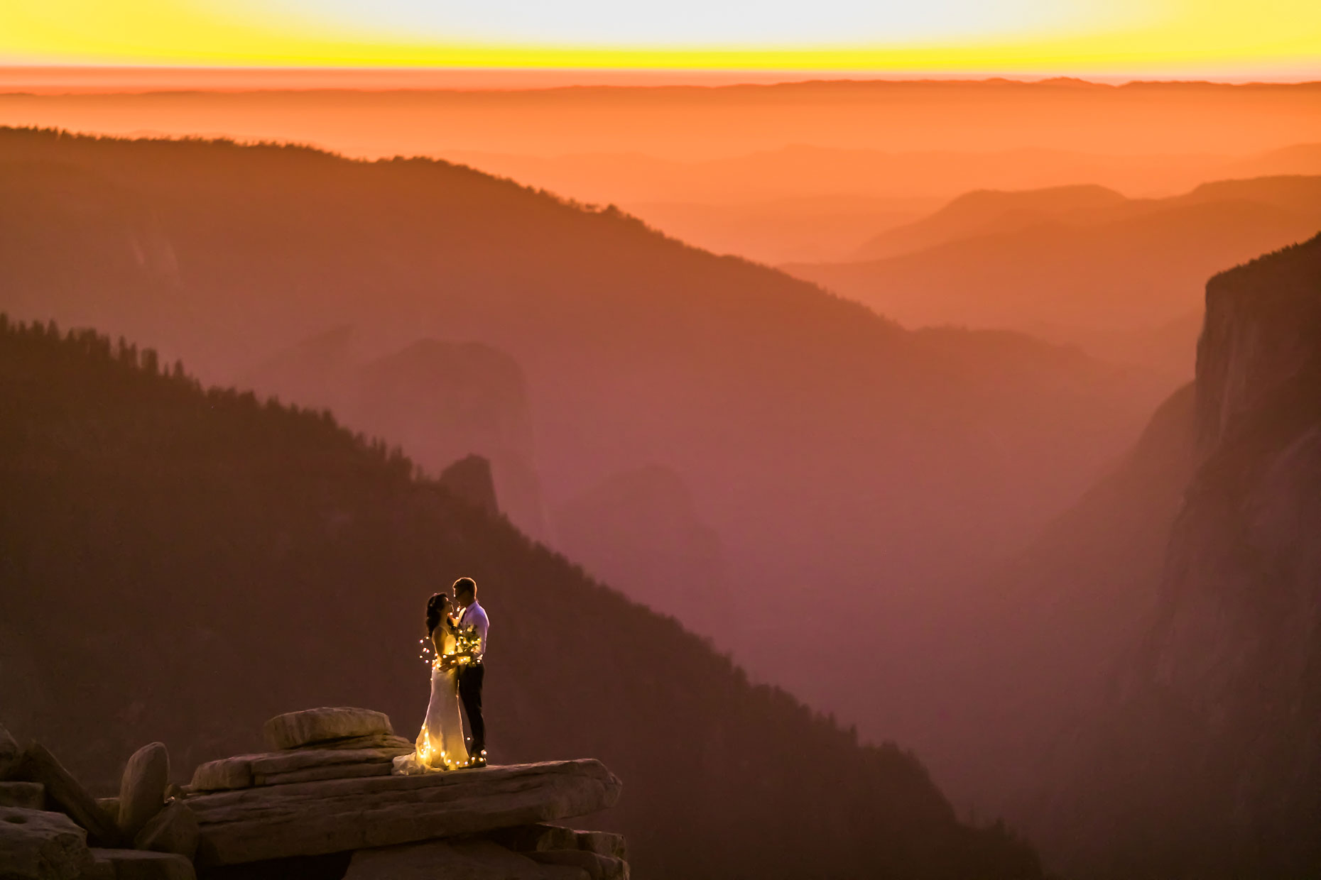 Half Dome fairy lights wedding pictures at sunset.