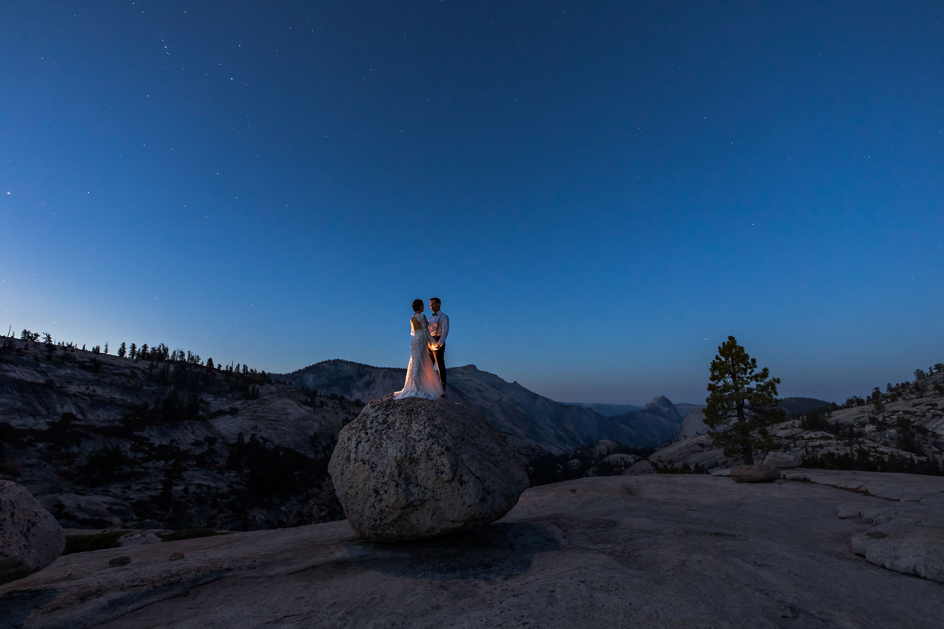 Wedding photography with stars and moon in Yosemite.