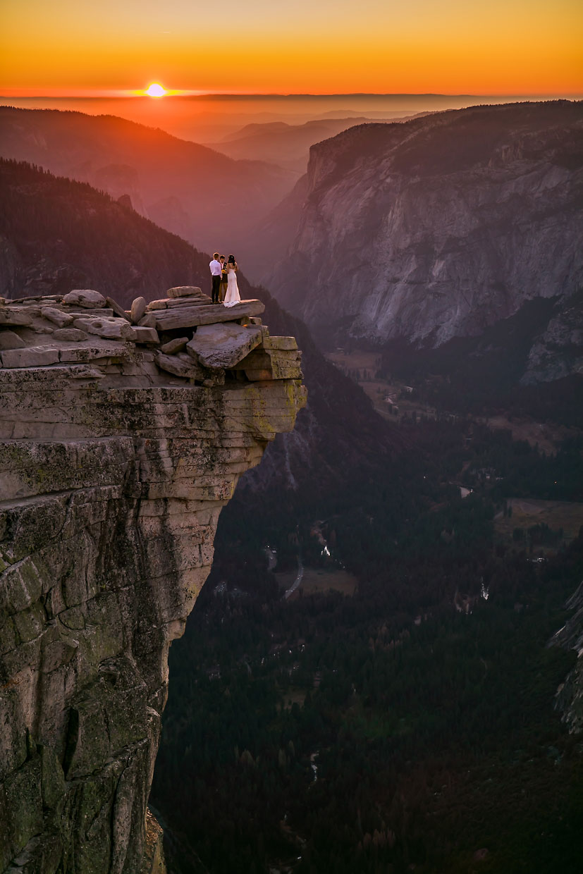 Adventure elopement photographer on the summit of Half Dome in Yosemite.