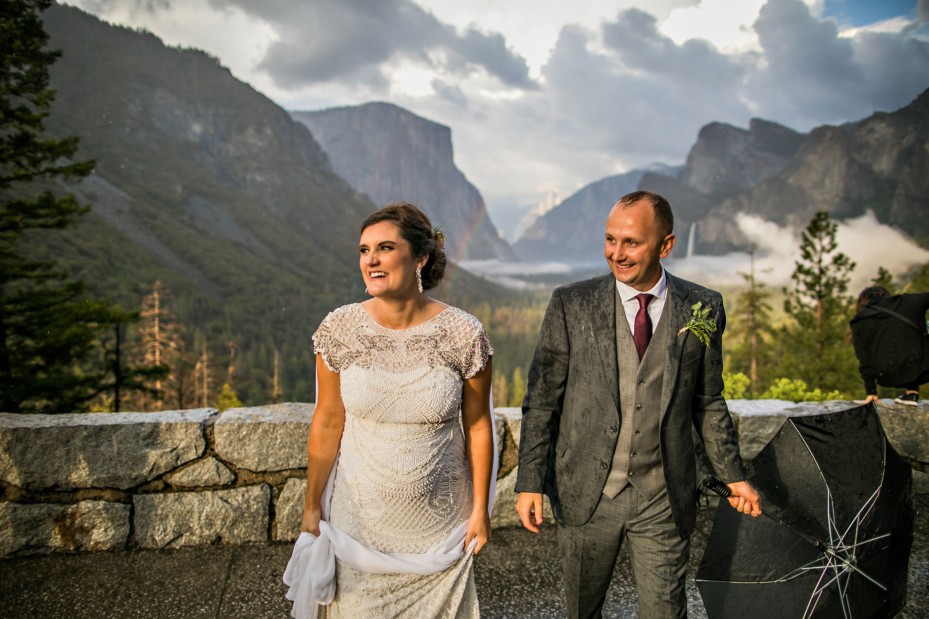 Happy wedding couple with rainbow in Yosemite.