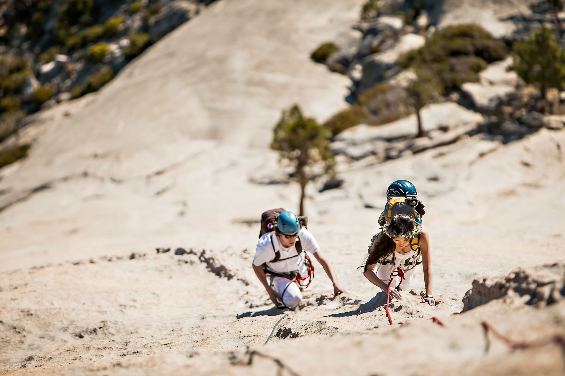 Bride & Groom climbing Snake Dike on Half Dome in Yosemite.