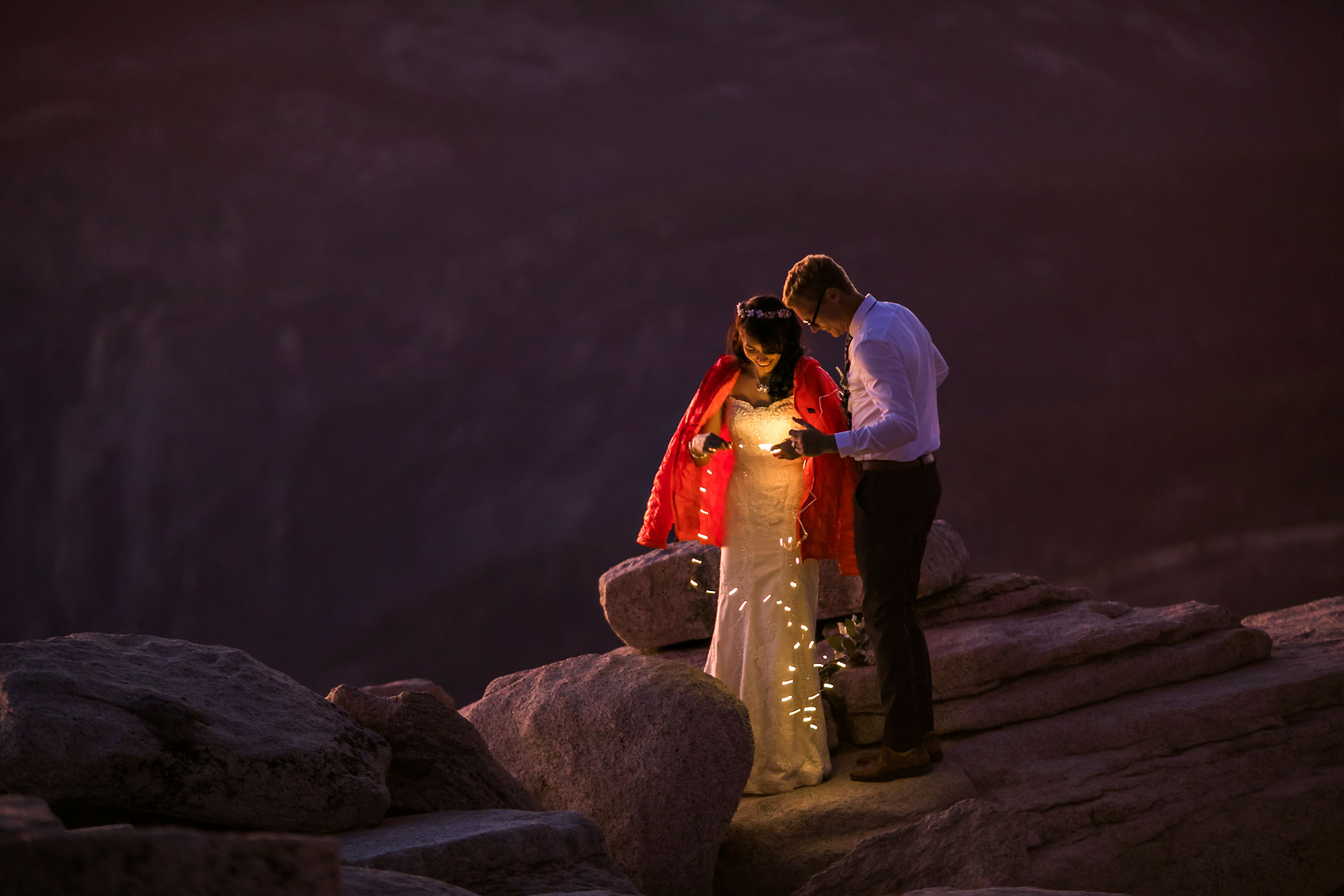 Wedding couple with fairly lights in Yosemite.