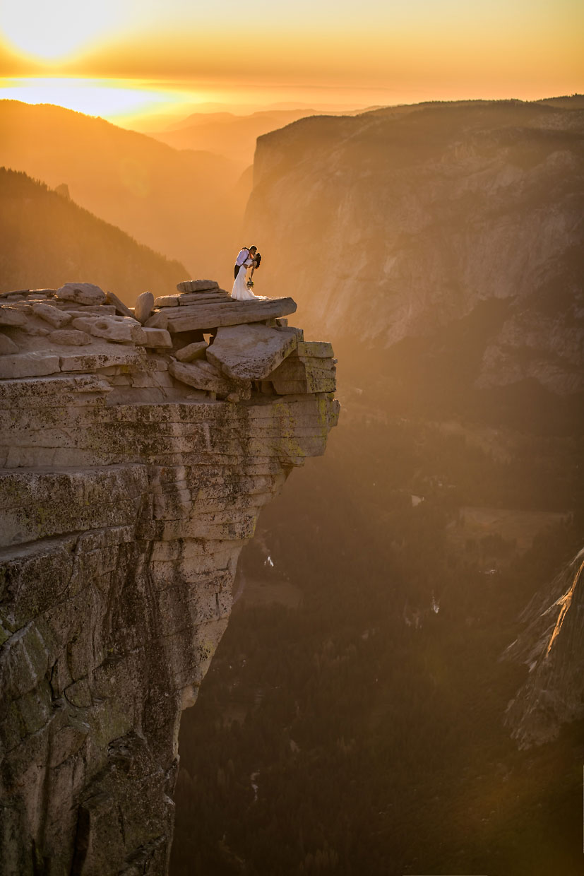 Wedding couple being romantic at sunset in Yosemite.